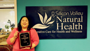 Dr. Julie Tran-Olive hods her Trademark Who's Who Top Doctors Honors Award.